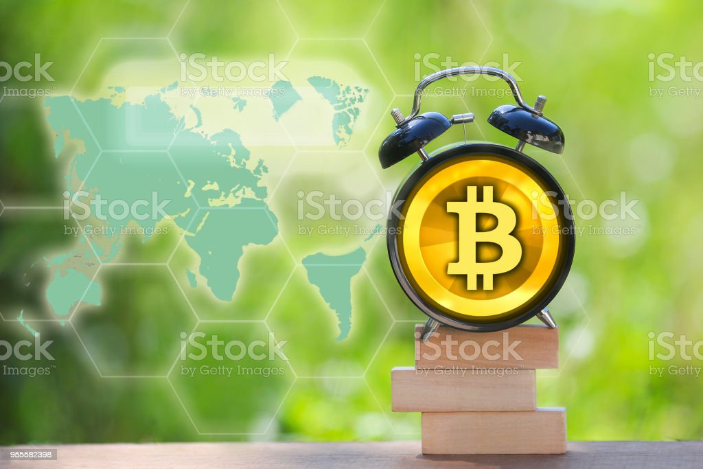 Bitcoin on black alarm clock with world map on background stock bitcoin on black alarm clock with world map on background royalty free stock photo gumiabroncs Image collections