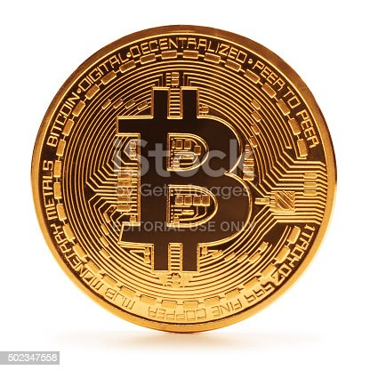 San Diego, California, Nov 16th 2015: The bit coin was invented by Satoshi Nakamoto in 2008 as a digital form of money but noone truly knows who  Satoshi Nakamoto is. Transactions are done through peer to peer networks without the need of a bank making it the first decentralized digital currency. This is a close up photo of one gold plated bitcoin symbolizing the bit coin market, modern technology, finance, internet, trading, etc.