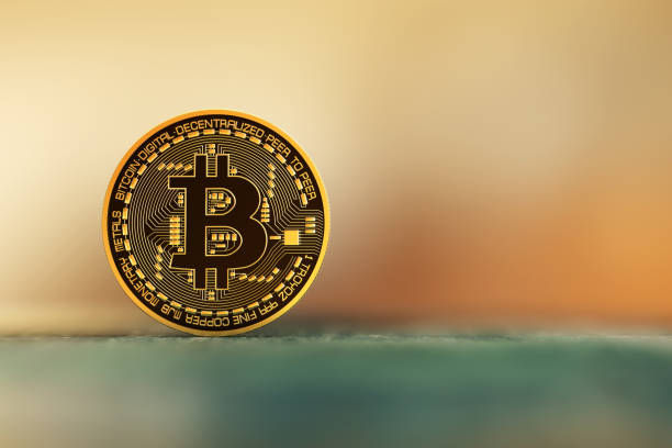 Bitcoin over a nice blurred background. stock photo