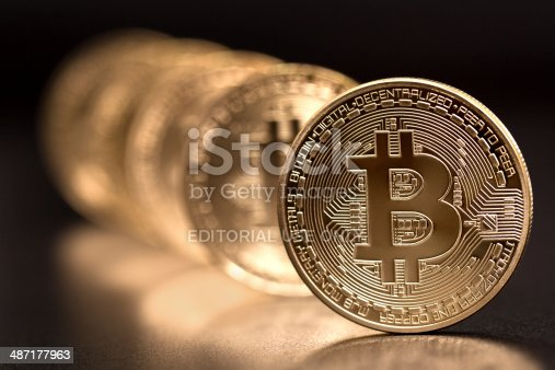 Sofia, Bulgaria - April 24, 2014: Studio shot of  bitcoin in a row on black background . Bitcoin - bit coin BTC the new virtual money