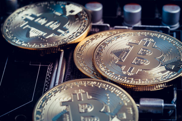 Bitcoin New York, USA - June 14, 2018: Close up shot of bitcoin memorial coins. Bitcoin is a cryptocurrency and a worldwide payment system invented by Satoshi Nakamoto in 2008. initial coin offering stock pictures, royalty-free photos & images