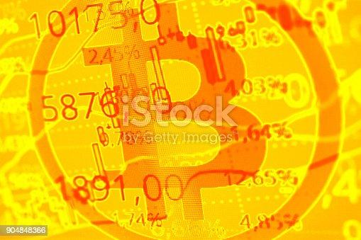 istock Bitcoin symbol and graph 904848366