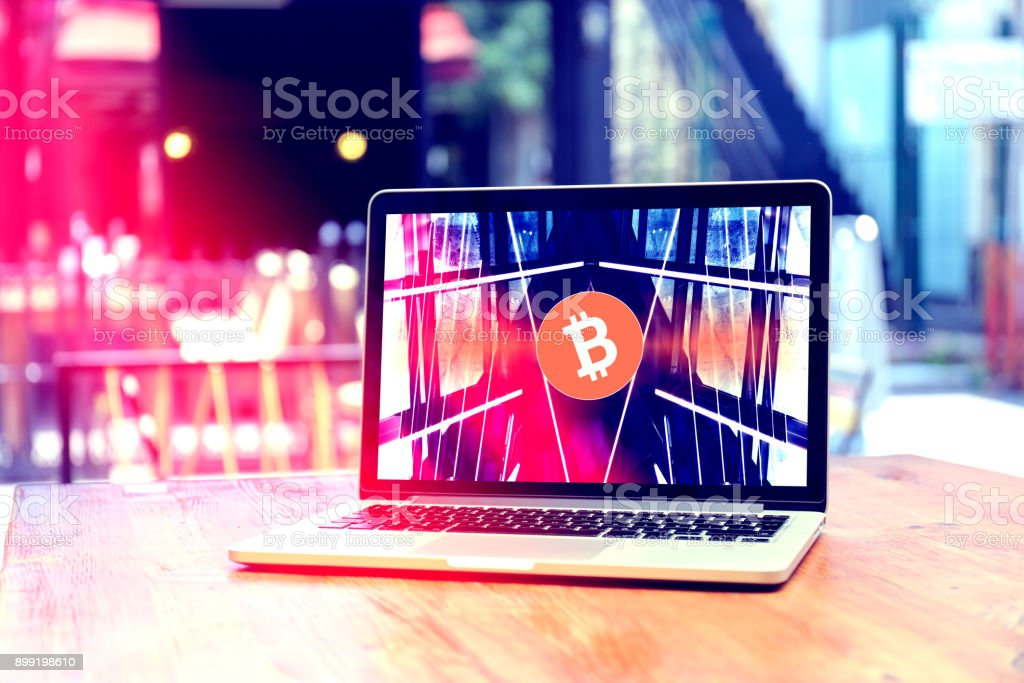 Bitcoin symbol on the display. stock photo