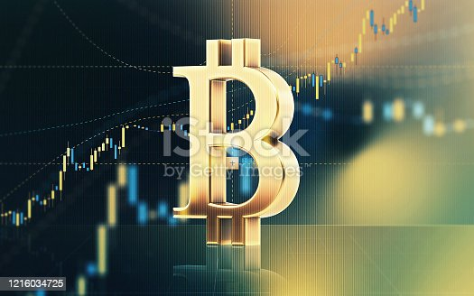 Bitcoin symbol sitting in front of bar graph. Selective focus. Horizontal composition with copy space. Stock market and finance concept.
