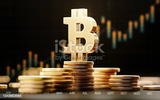 Metallic Bitcoin symbol with financial chart over dark background. Horizontal composition with selective focus and copy space.