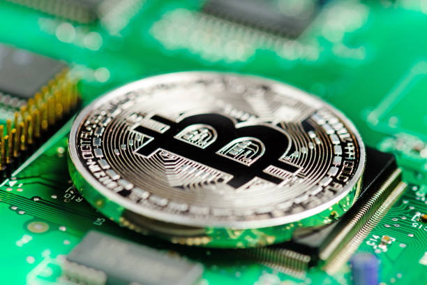 Bitcoin virtual currency on a circuit board stock photo