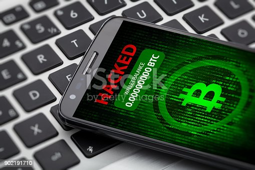 istock bitcoin wallet hacked message on smart phone screen. 902191710