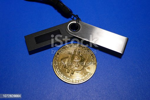 Vancouver, Canada, November 26, 2018: Bitcoin cryptocurrency coin - close up photo of one gold-plated bitcoin symbolizing the market, modern technology, finance, internet, trading, etc.