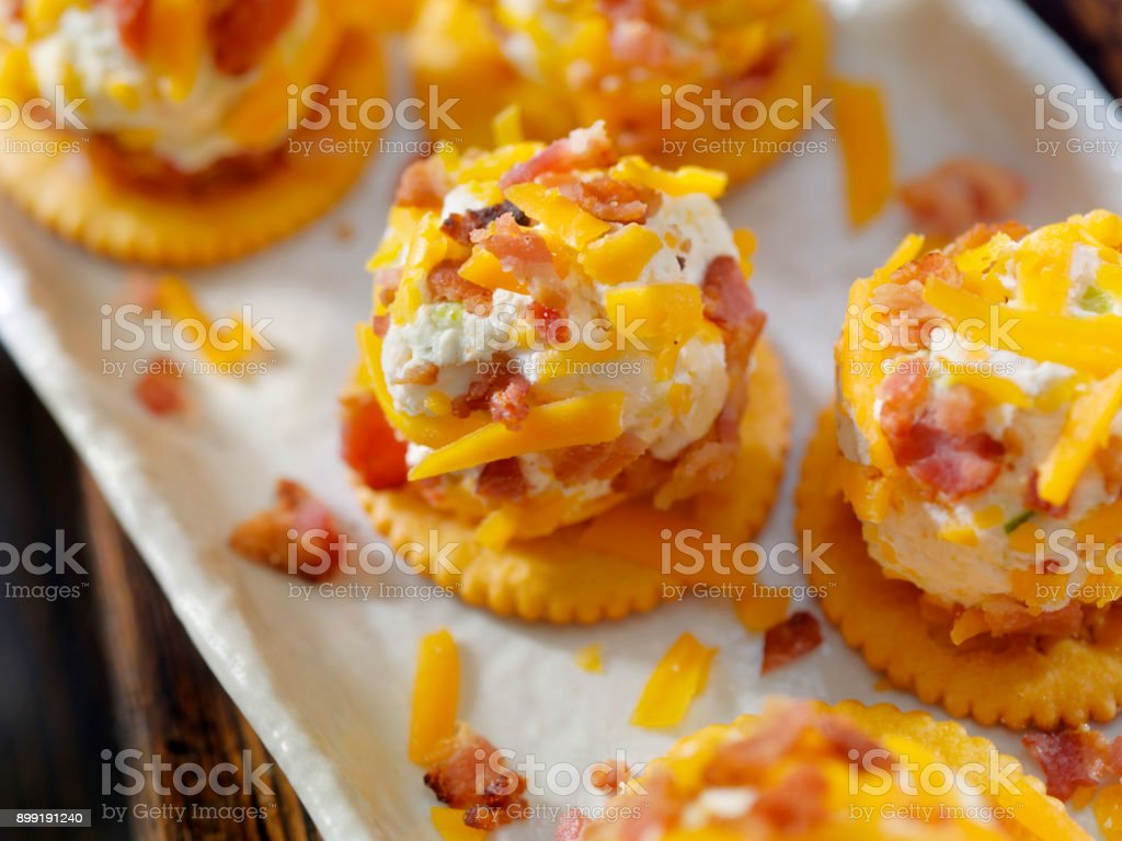 Bite Size Bacon and Cheddar Cheese Ball with Crackers stock photo