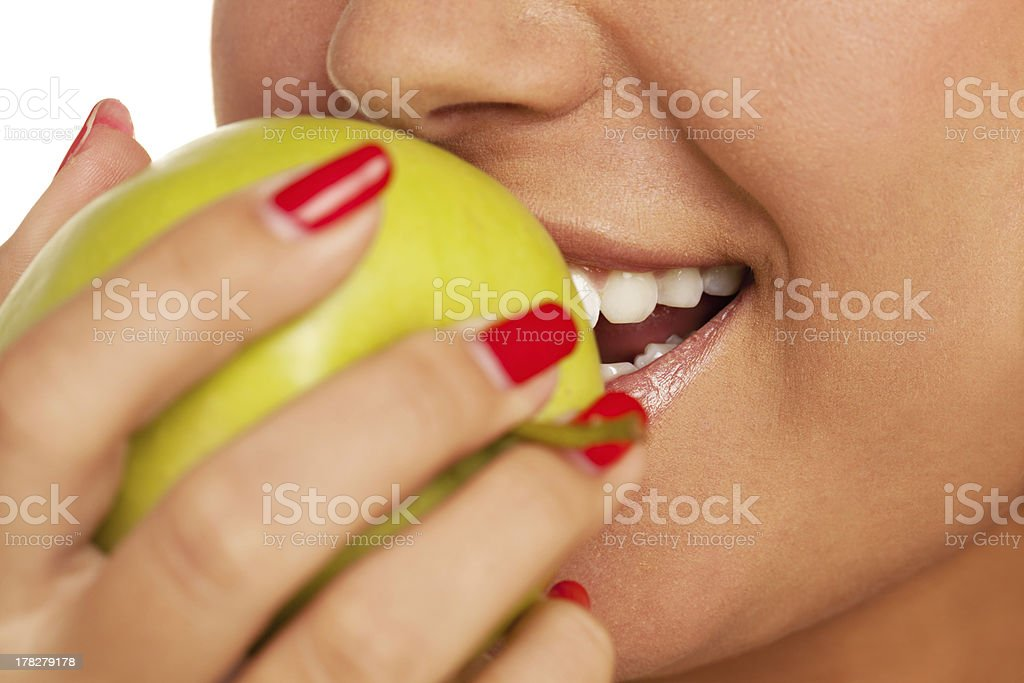 Bite the apple royalty-free stock photo