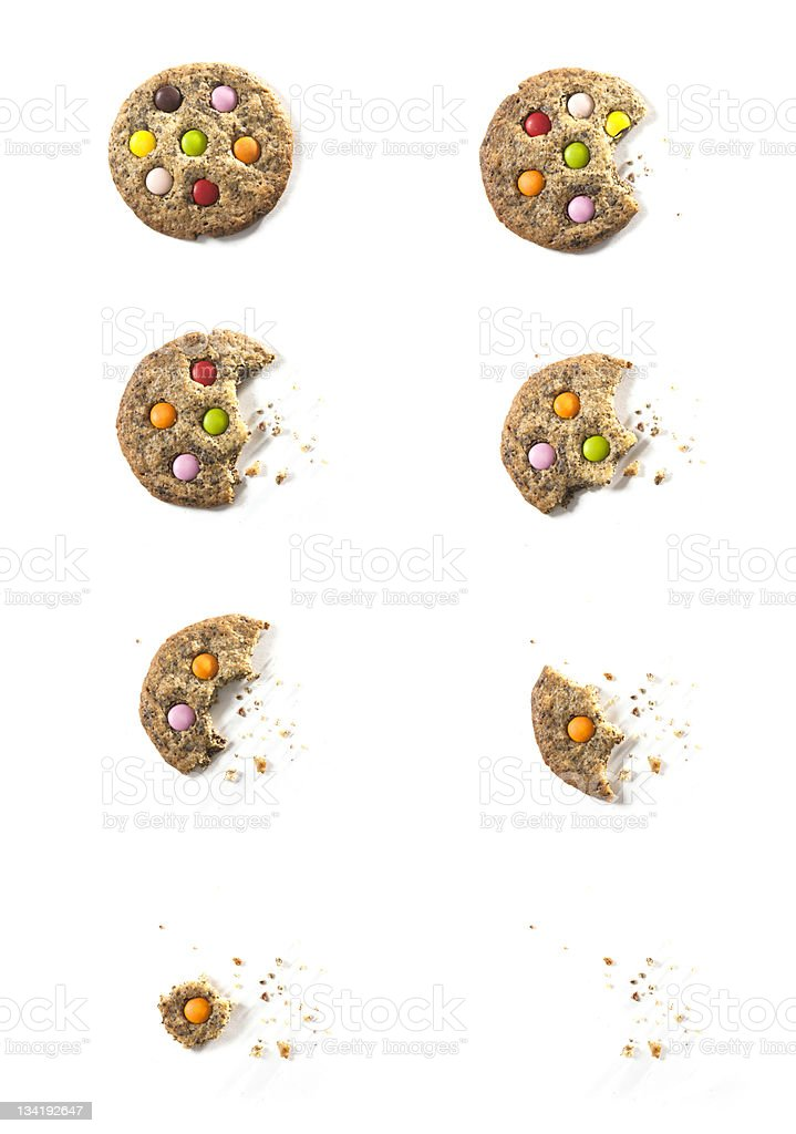 Bites of chocolate candy cookie with crumbs stock photo