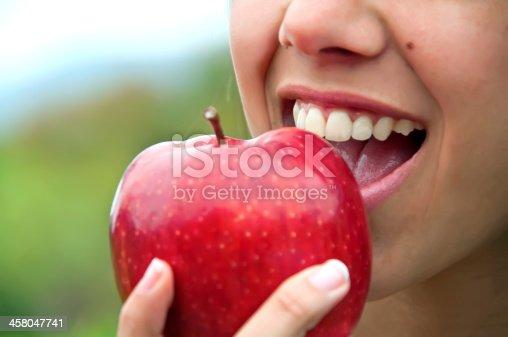 104545719istockphoto Biting an apple 458047741