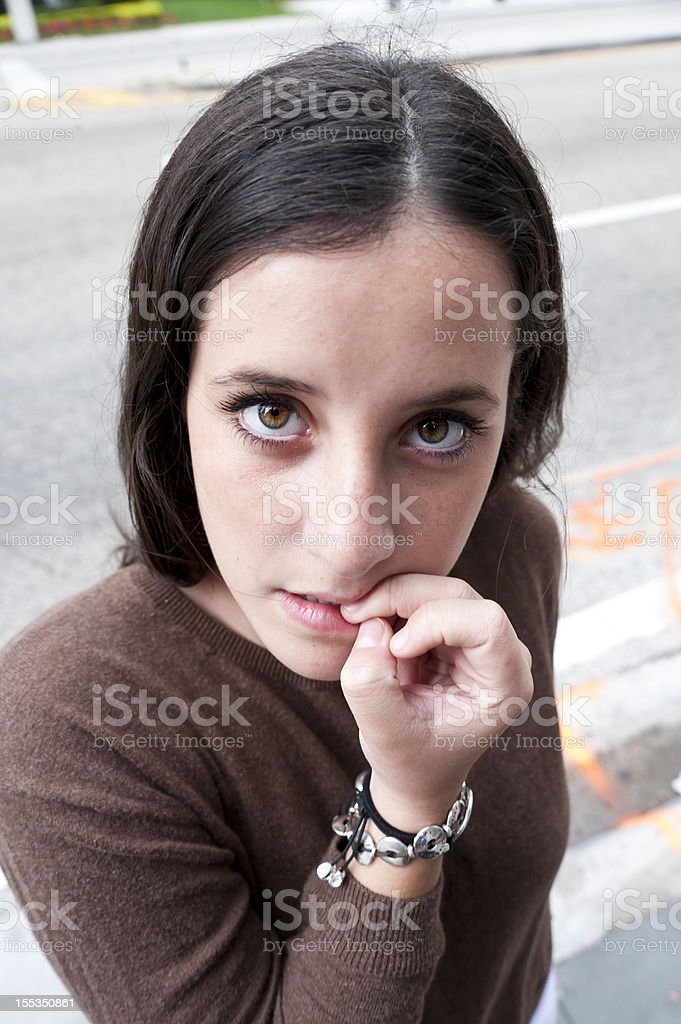 Biting her nails stock photo