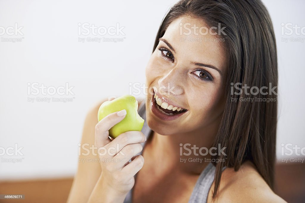 Biting into a juicy snack! stock photo
