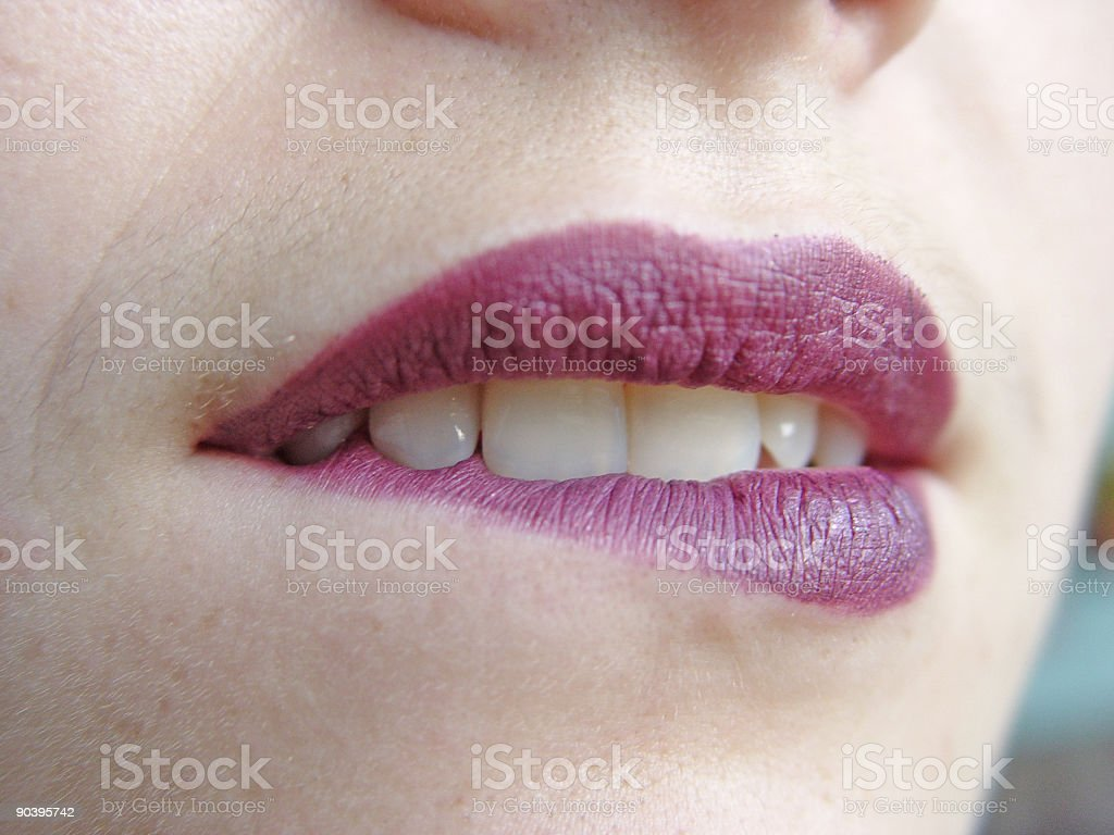 Biting lips stock photo