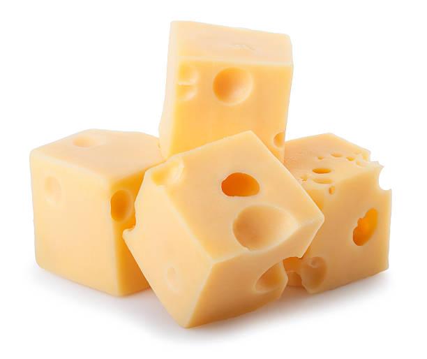 pezzi di formaggio sola su sfondo bianco - maasdam foto e immagini stock