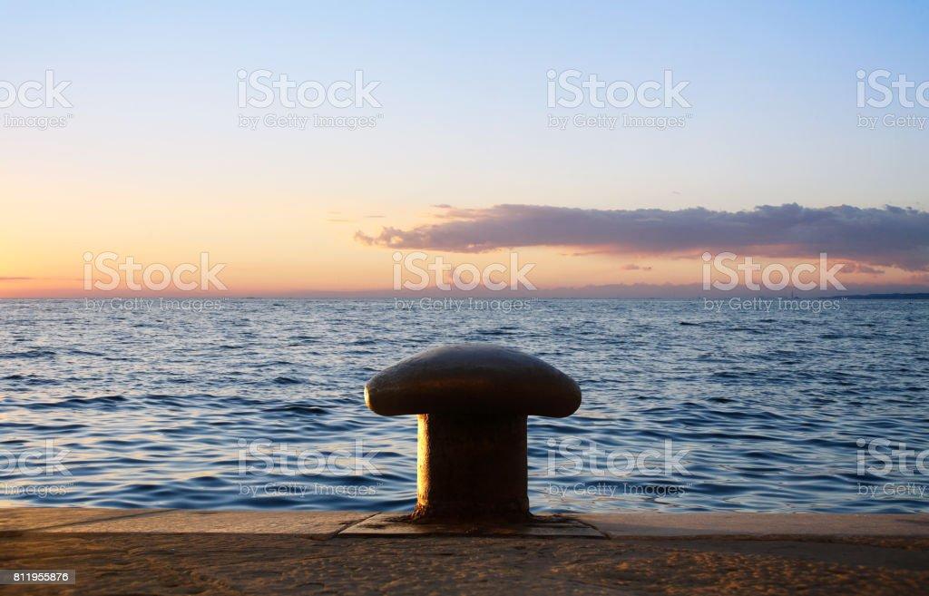 Bitt on a pier at sunset stock photo