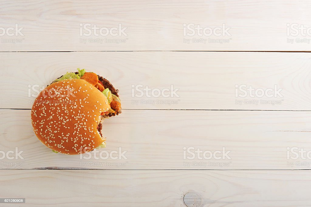 bitten bbq hamburger with vegetables, spices stock photo