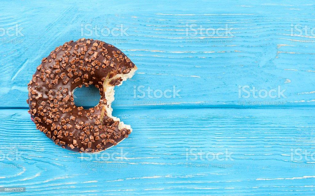 Bitten chocolate donut stock photo