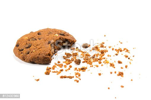 Bitten cookie with crumbs, isolated on white
