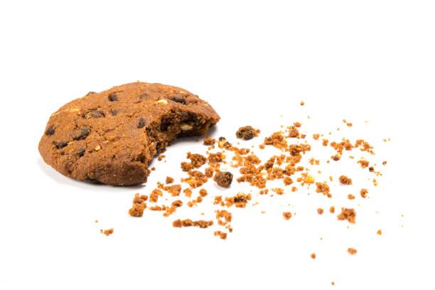 bitten cookie with crumbs - briciola foto e immagini stock