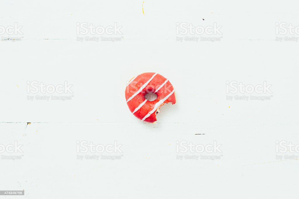 Bitten Donut On A White Table stock photo