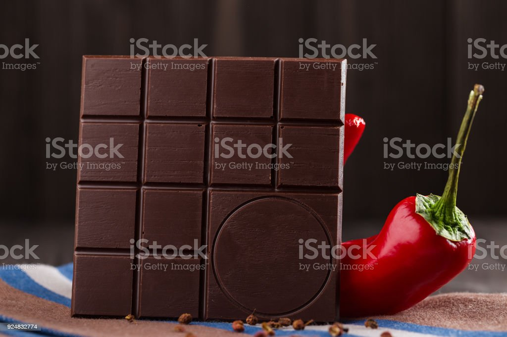 Bitter chocolate bar with chili and sichuan pepper. Copy space stock photo
