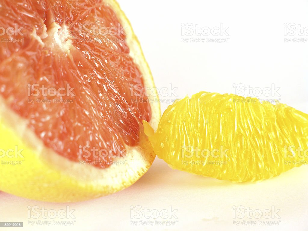 Bitter Grapefruit versus Sweet Orange stock photo