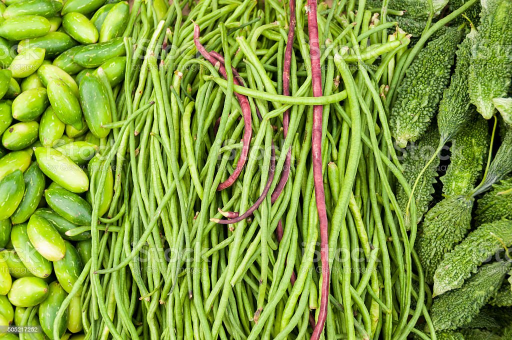 Bitter melon, cucumbers and longbeans at the market stock photo