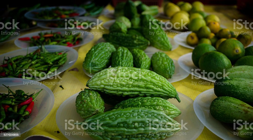 Bitter melon with vegetable background stock photo