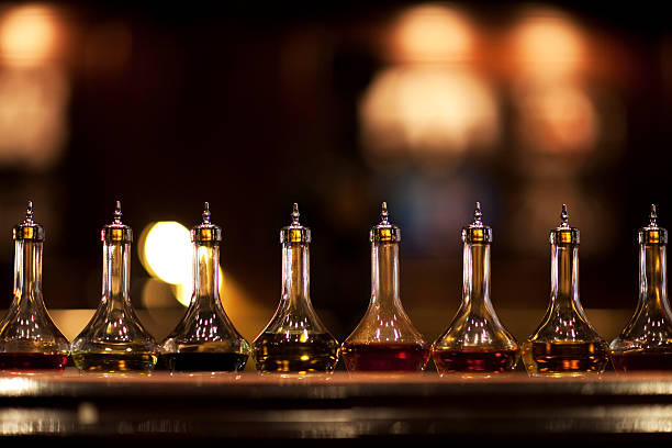 bitters lined up on a bar - dark beer stock photos and pictures