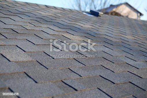 Bitumen tile roof. Roof Shingles - Roofing. Close up view on Asphalt Roofing Shingles .