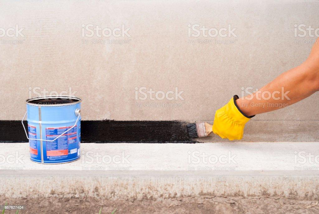 bitumen waterproofing of the foundation stock photo