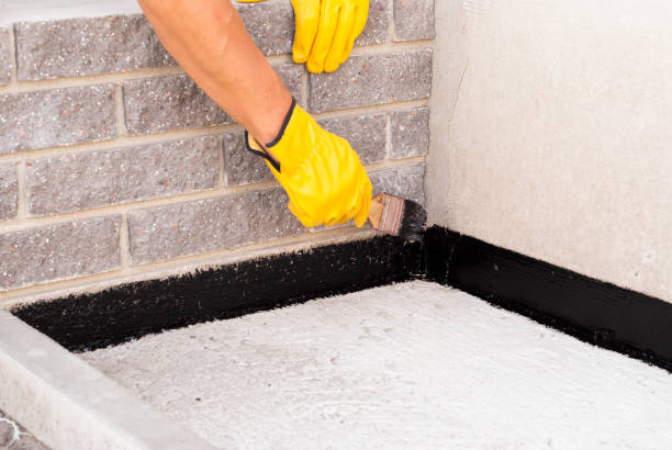 bitumen waterproofing of the foundation stock photo