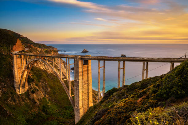 Bixby Bridge and Pacific Coast Highway at sunset stock photo
