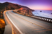 'Bixby Bridge on highway 1 near the rocky Big Sur coastline of the Pacific Ocean California, USA'