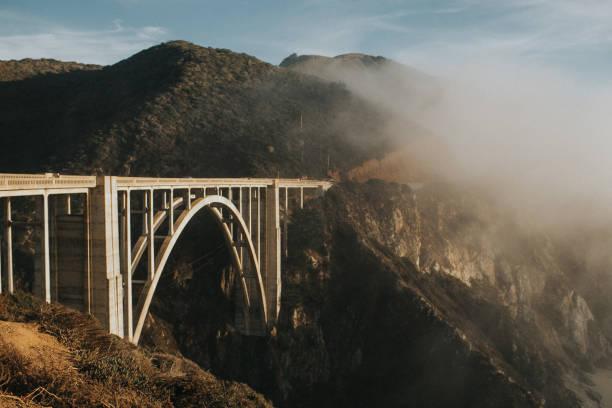 Bixby creek bridge with heavy fog in summer stock photo