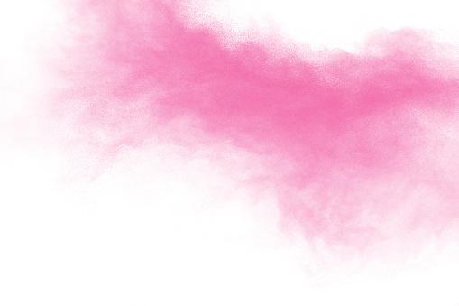 istock Bizarre forms of pink powder splatter on white background. 1137054874