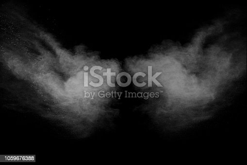 istock Bizarre forms of white powder explosion cloud against black background.White dust particles splash. 1059676388