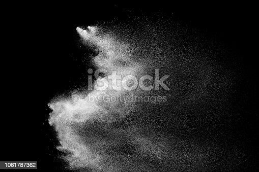 872058828 istock photo Bizarre forms of white powder explosion cloud against black background.White dust particles splash. 1061787362
