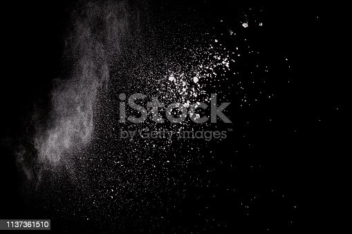 istock Bizarre forms of white powder explosion cloud against black background.White dust particles splash. 1137361510