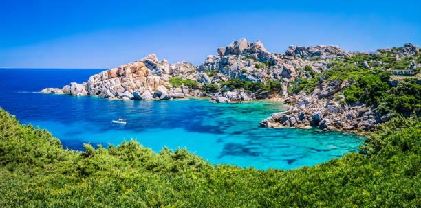 bizarre granite rock and azure bay in capo testa, sardinia, italy - sardegna foto e immagini stock