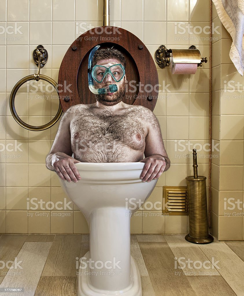 Bizarre man in vintage toilet stock photo