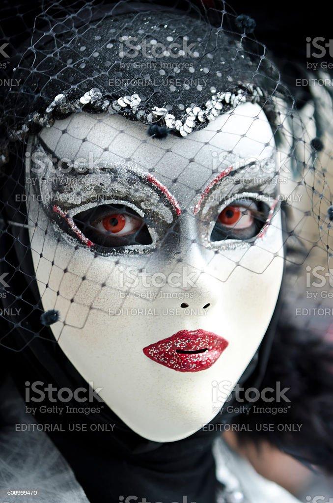 Bizarre woman in venetian mask stock photo