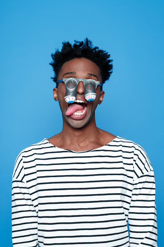 Bizzare Afro American Young Man Wearing Funny Eyes Mask Stock Photo - Download Image Now