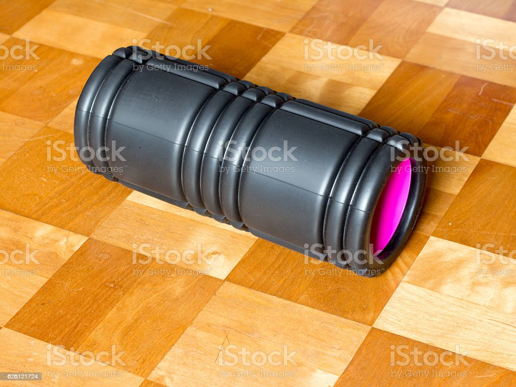 Bkack and pink foam roller stock photo
