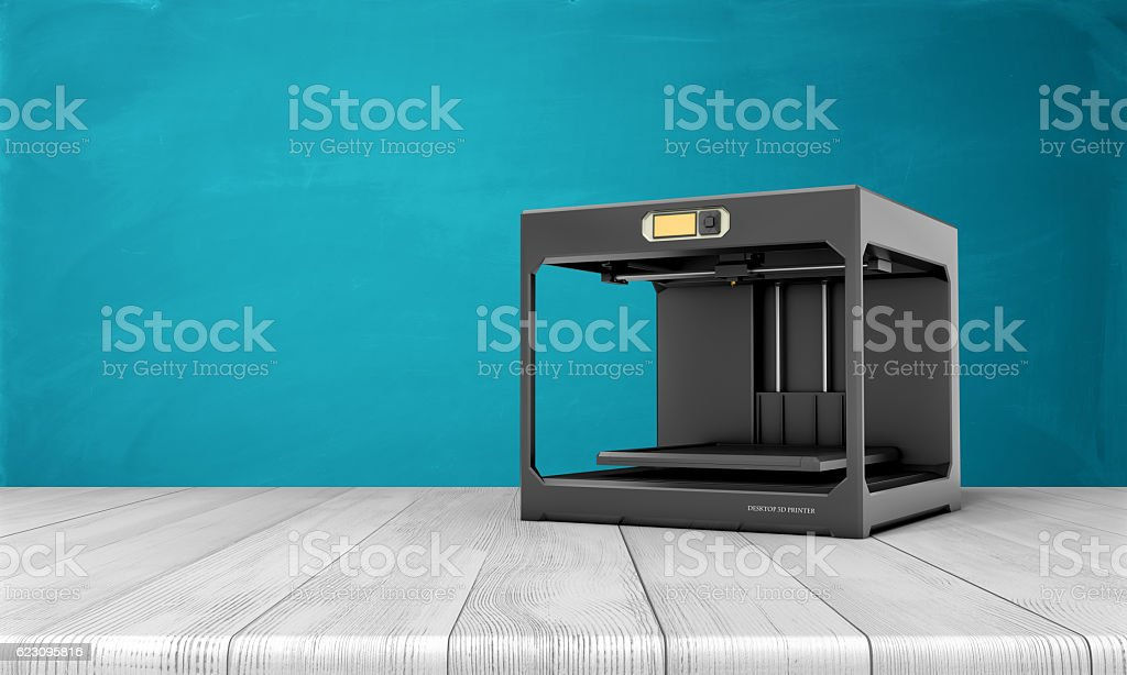 Black 3d printer standing on white wooden table with blue bildbanksfoto
