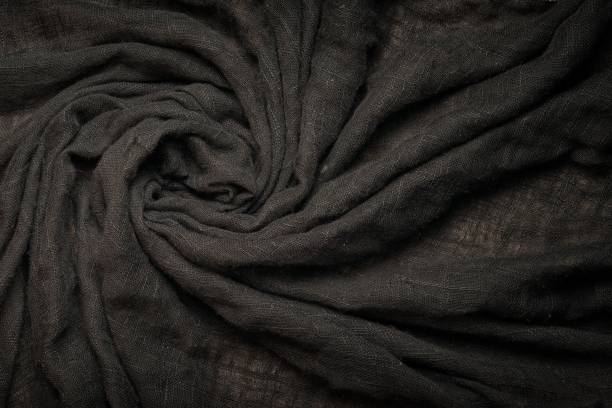 Black abstract swirl background linen cloth or liquid wave or wavy folds of grunge natural texture cotton material background or elegant wallpaper design, background