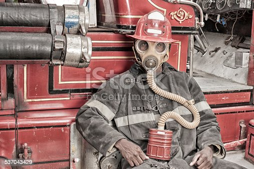 Black African American Firefighter From 1940 to 1960, Fire Truck.