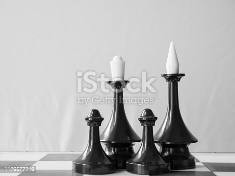 istock black African American happy family concept. four chessman on chessboard 1129677219